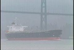 Ocean going tanker under bridge Stock Footage