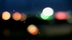 Defocused lights. Wet car window. Stock Footage