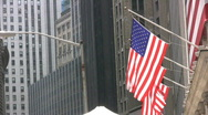 Stars And Stripes US Flag Hanging On Wall Street Manhattan New York Stock Footage