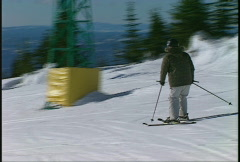 Sports and fitness, skier skis to ridge follow Stock Footage