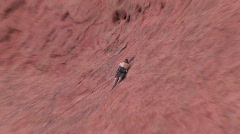 Climber on Red Rock Face - stock footage
