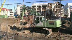 Construction crane demolishing building  Stock Footage