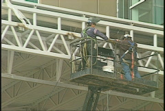 Construction workers on lift Stock Footage
