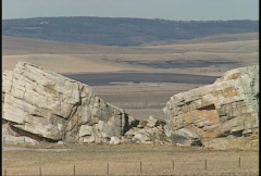 Big Rock, massive glacial erratic on the prairie, zoom back Stock Footage