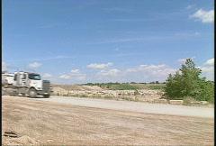 Trucking, gravel truck on dusty road Stock Footage