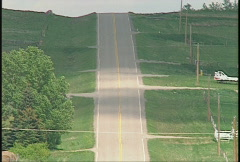 Country blacktop highway, lonely road Stock Footage