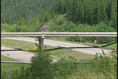 Trans-Canada Highway in mountains with overpass Stock Footage