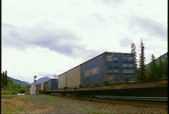 Railroad, intermodal container train westbound, fast, wide Stock Footage