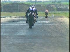 Motorsports, V-twin Superbike down front straight Stock Footage