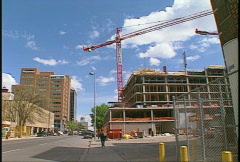 Construction crane, #6 and streetscape Stock Footage