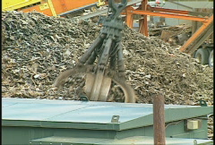 The environment, metal recycle grapple hook follow Stock Footage