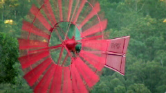 Red Windmill Spinning & Moving in Strong Wind Stock Footage