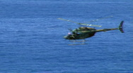 Stock Video Footage of Military Helicopter Flying Quickly Over Ocean - Army Aircraft at Sea