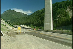 295' high Park bridge and crane close tilt up, under construction, Golden BC, #1 Stock Footage