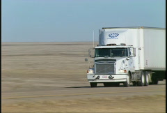 trucking, White Semi truck on highway  follow zoom - stock footage
