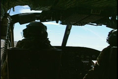 Military, flying, interior helicopter cockpit and pilots Stock Footage