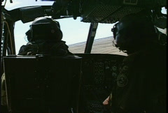 Military helicopter, flying, cockpit and pilots Stock Footage