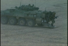 Military, soldiers leave coyote APC, attack Stock Footage