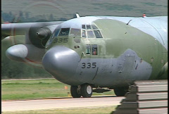 Military aircraft, C130 Hercules taxi,  2nd Herc landing Stock Footage