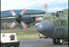 military aircraft, C130 Hercules taxi, engines cool down - stock footage