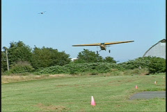 Aircraft, Fokker Super Universal, #6 landing on grass strip, rare Stock Footage