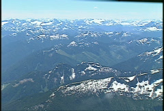 Aerial, aboard Fokker, mountains, snow many peaks Stock Footage