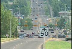 Light traffic, 14th street long lens Stock Footage