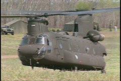 Military, US Army CH47 Chinook lift off and flight Stock Footage