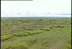 Aerial, low level helicopter flight over prairie Stock Footage