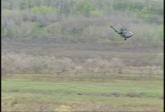 Military, UH60 Blackhawk helicopter fast and low flyby Stock Footage