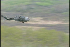 military, UH60 Blackhawk helicopter fast and low flyby - stock footage