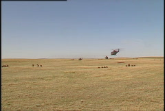 Military helicopters and soldiers, zoom in, air assault Stock Footage