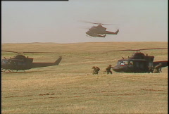 Military helicopters landing, soldiers getting out, air assault Stock Footage