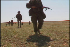 Military, soldiers walking, silhouetted  Stock Footage