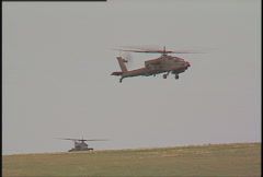Military, hovering AH64 Apache helicopters, #2 Stock Footage