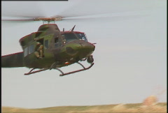 Military helicopter coming in for landing Stock Footage