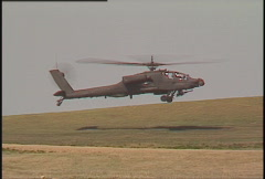 Military, very low hovering AH64 Apache and soldiers Stock Footage