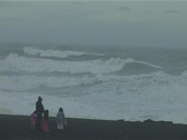 People and storm waves Stock Footage