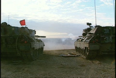 Military, leopard tank firing, #9 from behind Stock Footage