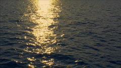 Realtime sundown reflection wide ocean Stock Footage