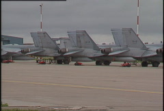 Military, F18 hornets on tarmac pan Stock Footage
