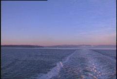 Gulf island sunrise, ship's wake Stock Footage