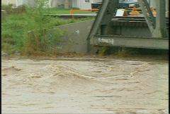 Flooded river rail bridge, #1 pan Stock Footage