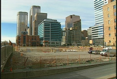 Empty lot surrounded by office towers Stock Footage