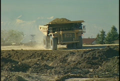 Construction, Cat 777d dump truck, #1 mountains in distance Stock Footage