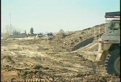 Construction, Huge dump truck, #4 through frame Stock Footage