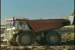 construction, Huge dumptruck, #2 loads up - stock footage