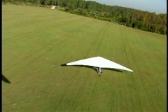 Steady shot of Hang Glider Floating Over Another Hang Glider Stock Footage