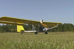 Pilot Flies Ultralite Aircraft Towing Hang Glider Aerial Stock Footage