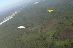 Hang Glider Being Towed by Plane and then Released Stock Footage